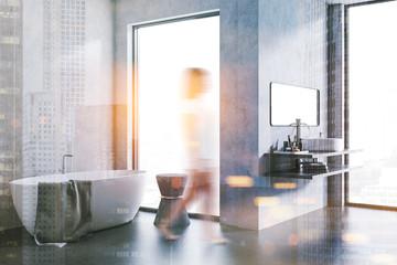 Concrete wall loft bathroom interior. Woman