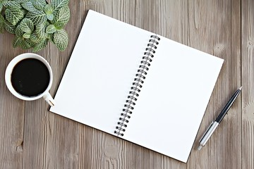 Still life, business, office supplies, planning or office life concept : Top view or flat lay of open notebook with blank pages, coffee on office desk table with copy space ready for adding or mock up