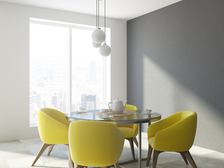 Yellow chair dining room corner, white wall