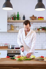 Image of man cooking dinner on table