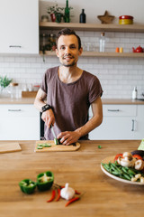 Picture of man cooking vegetables on table