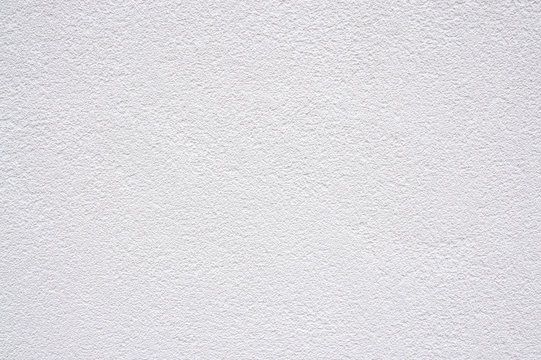white roughcast plaster wall background texture pattern