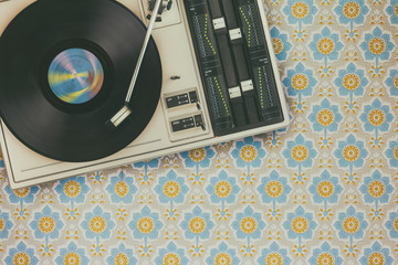 Record player on top of flower wallpaper