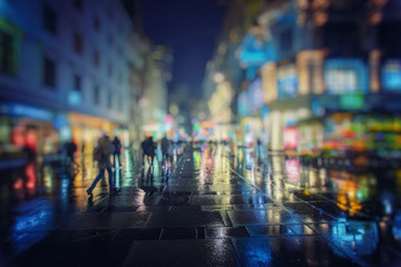 crow of people walking on rainy night in the city  Fotomurales