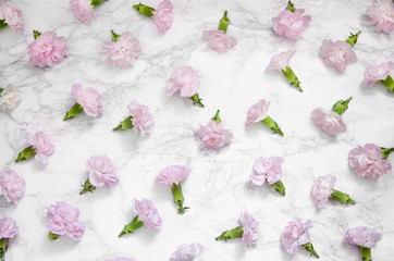 Flowers composition. Frame made of carnations on marble background. Flat lay, top view