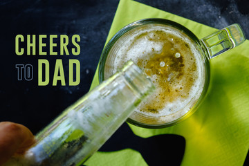 Father's day graphic with cheers to dad text and beer pouring into glass.