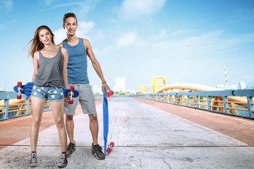 Young man and woman with skateboard