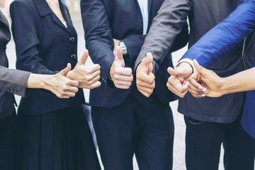 Team business partners giving Thumb up ,Successful teamwork partnership , business concept