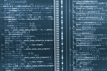 Closeup of Java Script, CSS and HTML code. Background of software developer script. Website design. PHP data source file. Programming code abstract technology. JavaScript code in text editor.