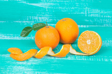 orange fruit on color table background.