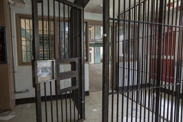 Metal bars leading into cellblock in prison