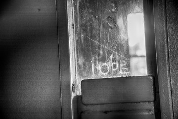 Hope in prison door in black and white