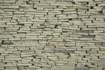 The texture of a wall made of stone slate