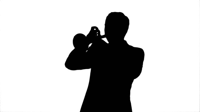 Silhouette Young musician playing trumpet