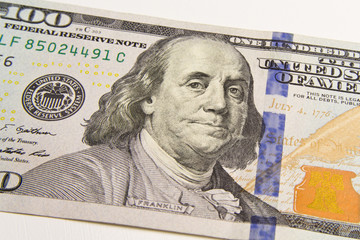 Front of the one hundred dollar bill with a Portrait of President Benjamin Franklin's close-up