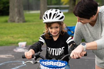Girl learning to ride a bike