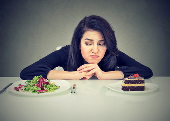 Young woman having problems with diet choice