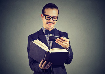 Happy man taking photo of book content