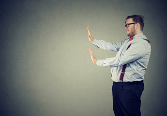 Man gesturing in request to stop