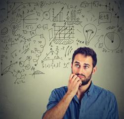 Pensive man creating business plan