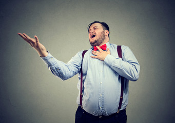 Chubby man singing sad opera