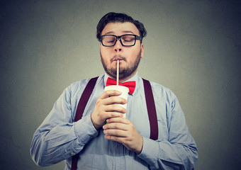Obese man enjoying sugar soda