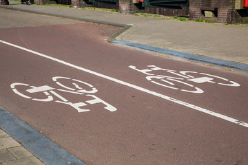 White bicycle sign on the road with two way traffic