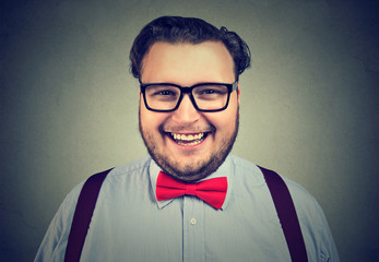 Happy eccentric man in bow tie