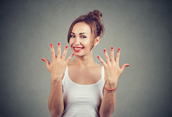 Happy woman showing modern manicure