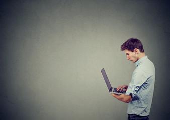 Teen man using laptop