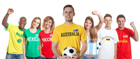 Australian soccer supporter with fans from other countries
