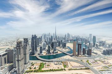 Aerial view of modern city skyscrapers in Dubai, UAE.