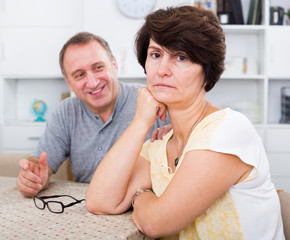 Sad mature woman experiencing family problems