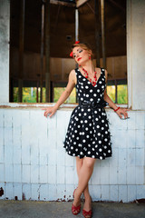 beautiful young woman posing in retro dress