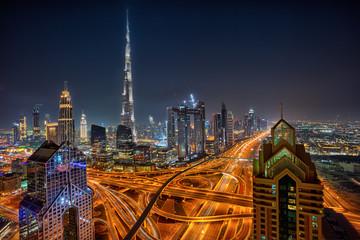 Dubai skyline during night with amazing city center lights and Sheikh Zayed road traffic,United Arab Emirates.