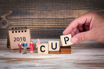 cup, 2018 calendar. Sports competitions, success at work or achievements in training. Wooden letters on the office desk, informative and communication background