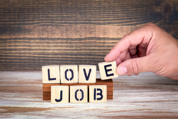 Love job, business and career. Wooden letters on the office desk, informative and communication background