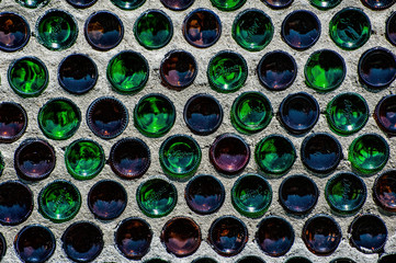 Wall of green and red beer bottles