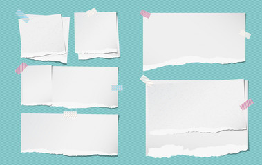 White note, notebook grainy paper pieces with torn edge stuck on squared blue backgroud. Vector illustration.