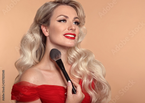 Beauty makeup. Fashion glamour portrait of happy smiling blonde woman with red lips and long