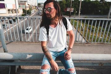 Stylish man with sunglasses and beard
