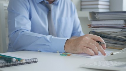 Businessman Working in Office Room With Financial Documents