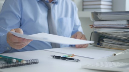 Businessman Working With Financial Documents In Accounting Office