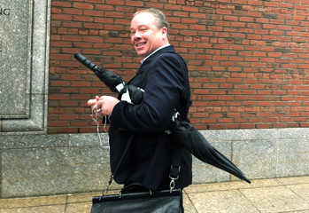 McLellan, a former executive vice president of State Street Corporation, exits the federal courthouse in Boston
