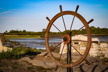 Ship wheel along the coast
