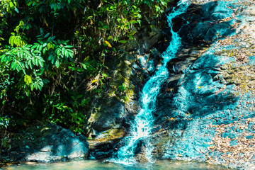 Waterfall and green rainforest in Langkawi, Malaysia.