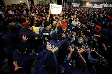 Policemen secure Jordan Prime Minister's office during a protest in Amman