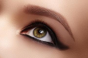Closeup Female Eye with Dark Make-up, great Shapes Brows. Celebrate Makeup, Luxury Eyeshadows. Fashion Eyeliner, pencil