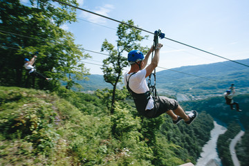 zip line on the sky high in the mountains over a beautiful forest.