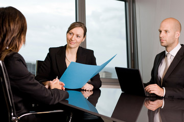 Job interview with two persons from a human resources team and a candidate